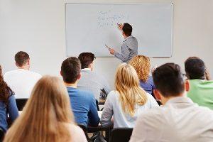 http://www.dreamstime.com/stock-images-teacher-whiteboard-class-teaching-business-studies-university-image29748764